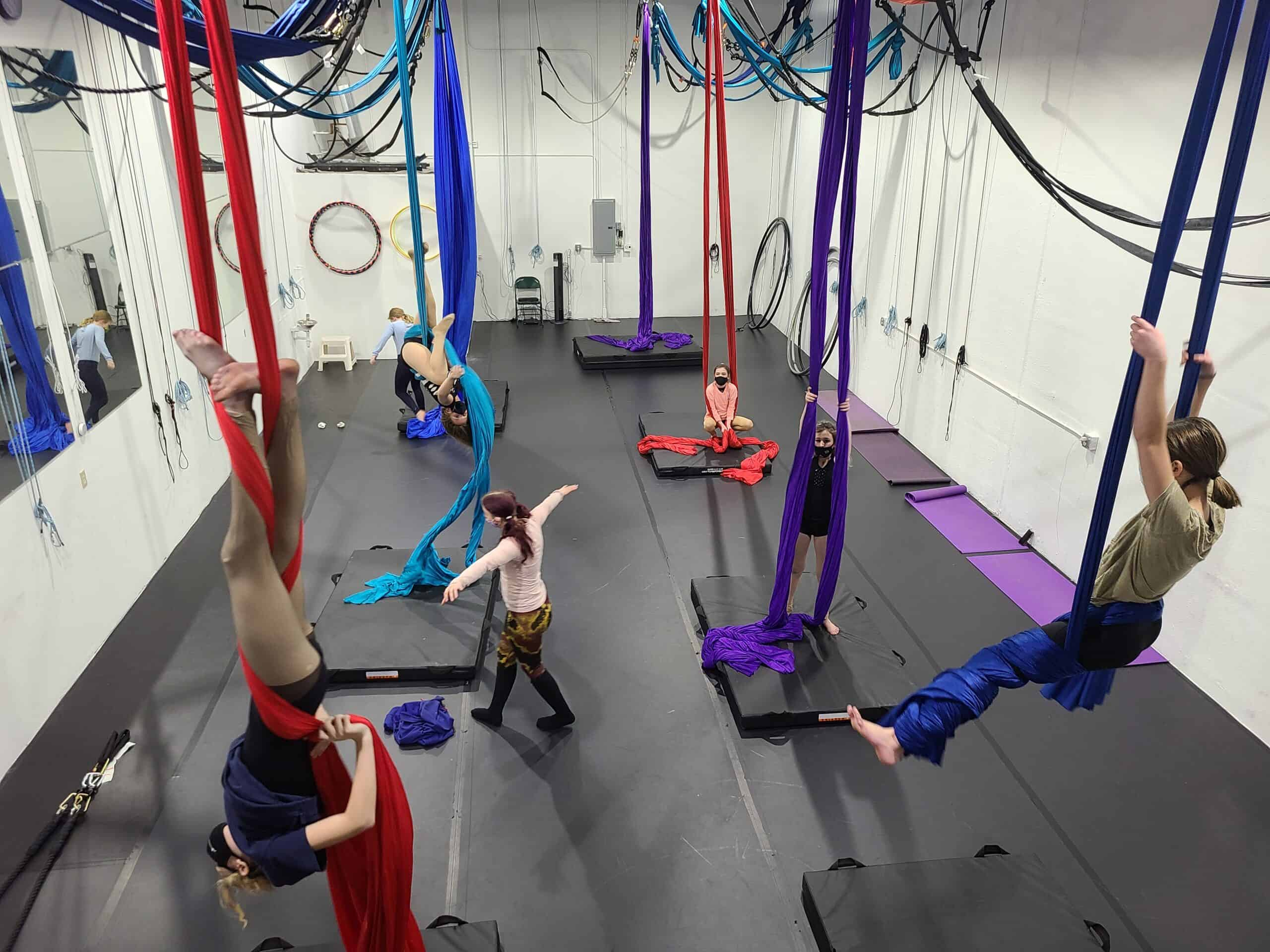 Kids aerial dance playing on the silk during aerial camp