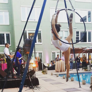 Hired aerial performer at an event performing hoops