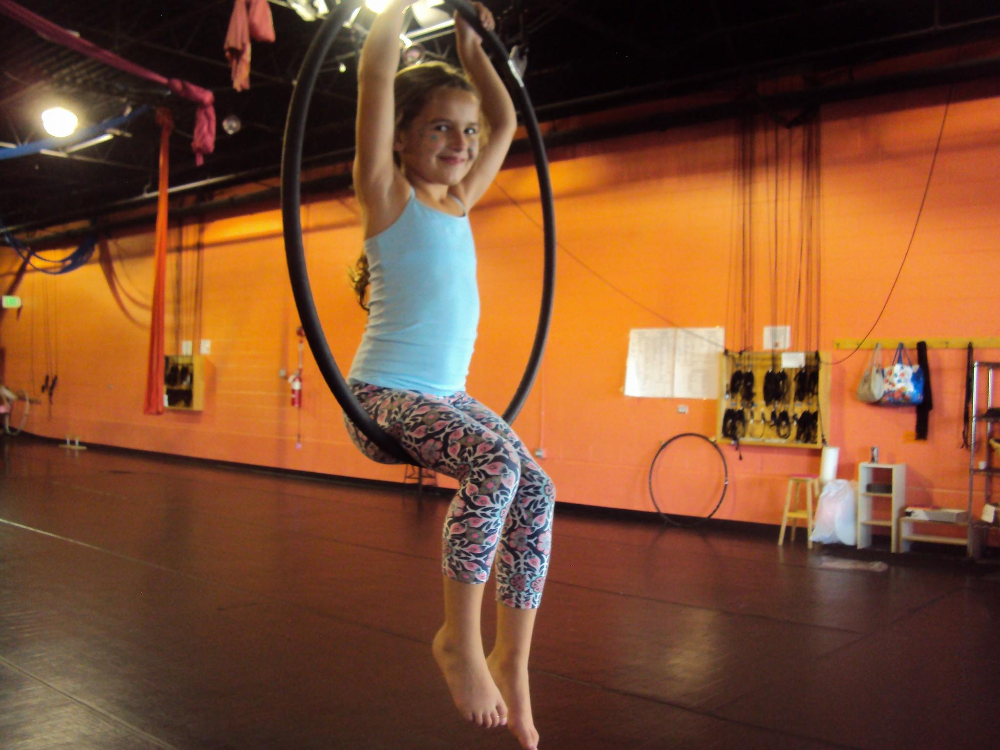 Aerial dance youth student using the hoop